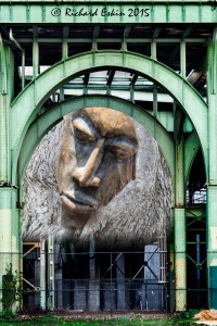 Treeman. These arches in NY City seemed so perfect except for the confusion behind them. So I put a wooden carving into a nearby knothole and used that to fill in the arch.